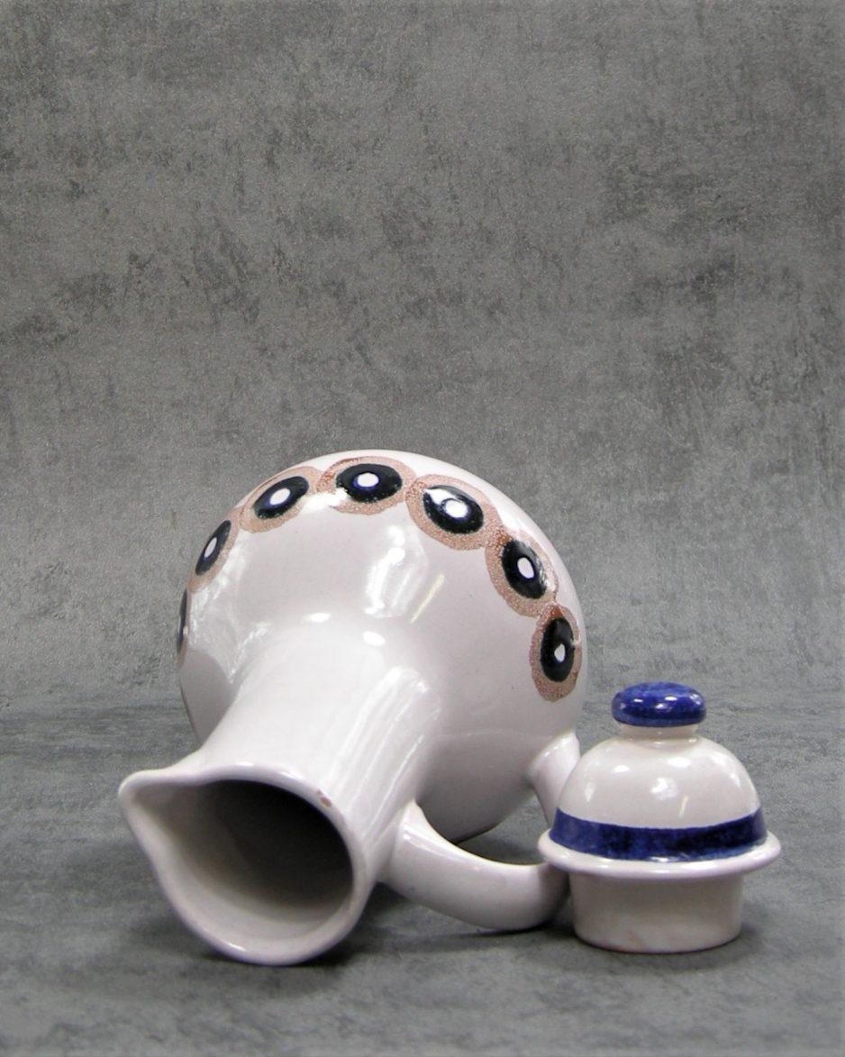 242-kan-pitcher-609-roze-blauw-bruin